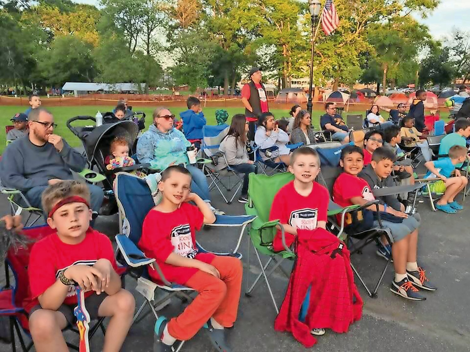Scouts in Pack 367 and their parents prepared waited in front of the Bandshell on the Village Green for the skits to start.
