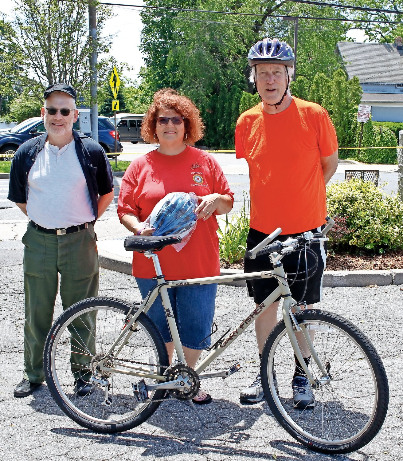 The Oceanside Lutheran Church partnered with the New York Coalition of Transportation Safety to hold a bike blessing and safety rodeo. Lowell Wolf, NYCTS, Debbie Chapman, Church Council President and Mark Hoffacker NYCTS helped to show children the proper safety requirements for bikes.