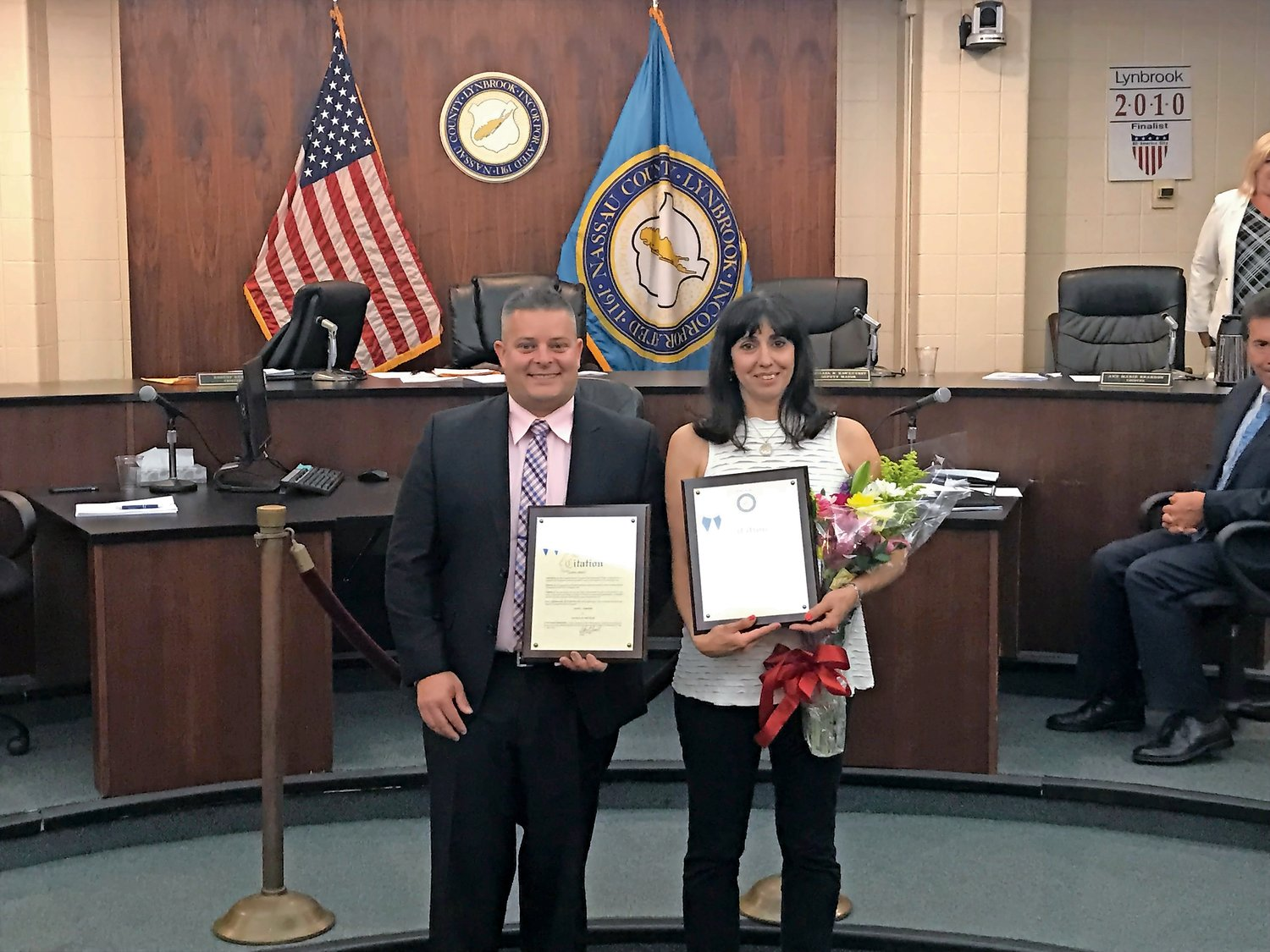 Daniel Ambrosio and Andrea Wong were named Lynbrook's Man and Woman of the Year, respectively, at the village board meeting on June 3.