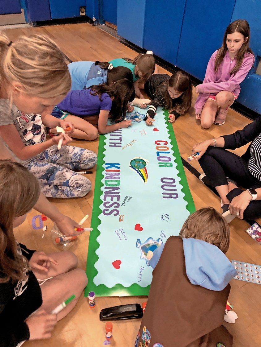 All of Watson's Girl Scout troops signed the banner and pledged to be kind.