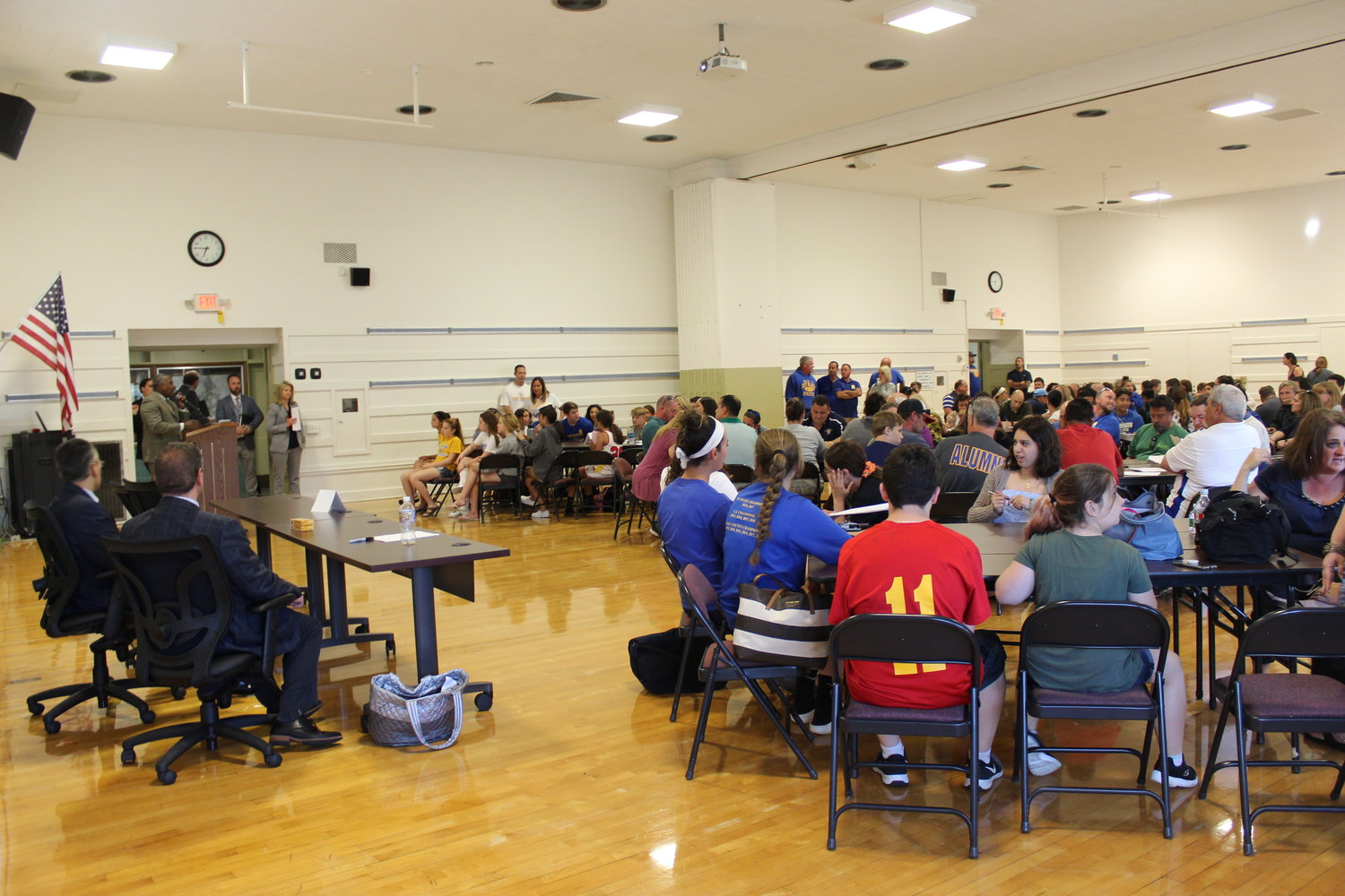 Dozens of student athletes and community members attended a June 3 public forum hosted by the East Meadow School District to discuss whether the district should install new natural-grass fields or opt for synthetic turf.