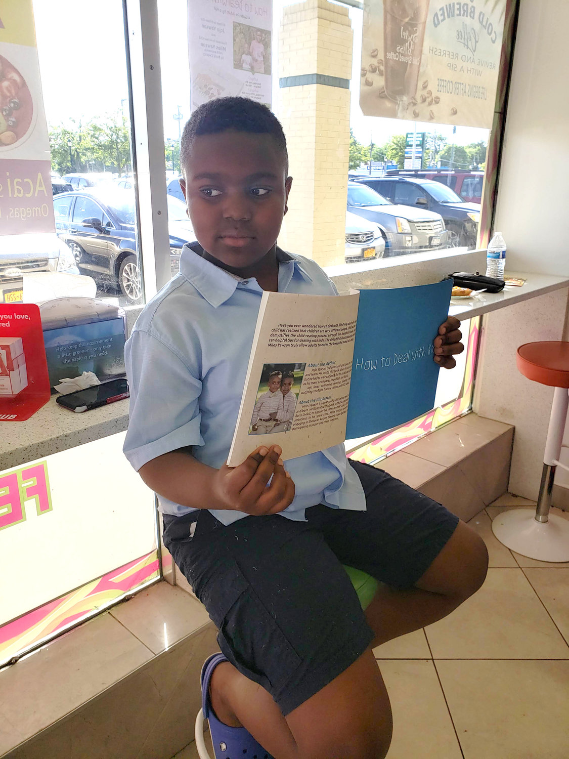 "Jojo Yawson, 9, from Freeport debuted his book, ""How to Deal with Kids"" on June 8 at Swirl Bliss in Baldwin where he held a reading and a book signing event."