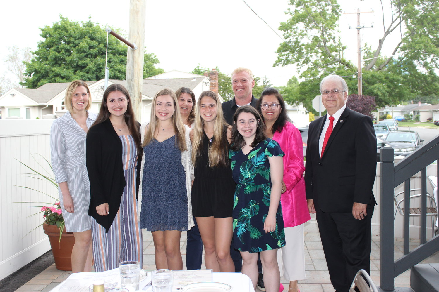Emily Carman, bottom-left, Kaitlyn Surless, Stefanie Botman and Hailey Schiller earned the East Meadow Chamber of Commerce scholarship. They were with scholarship committee members Lyndsey Gallagher, Rosemary Basmajian, Chamber President Michael Levy, Christine Mooney and Doug Wood at the chamber's June 5 meeting at Major's Steakhouse in East Meadow.