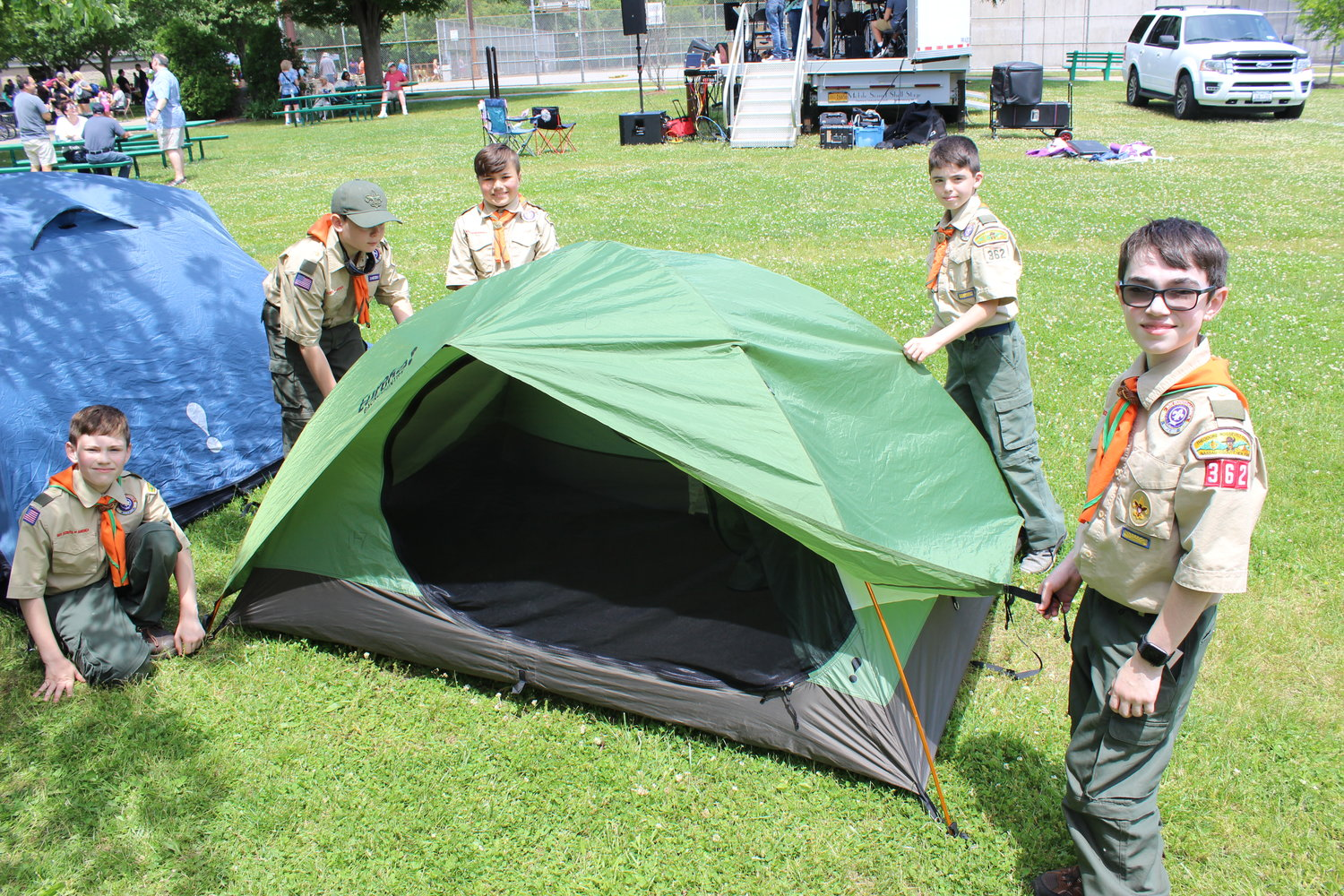 Connor Gilmor, left, Jared Waldman, Garrett Wanser, Jaiden Wevman and Logan Capozzoli, all of Boy Scout Troop 362, demonstrated pitch-tenting to guests at the 28th East Meadow Community Pride Day.