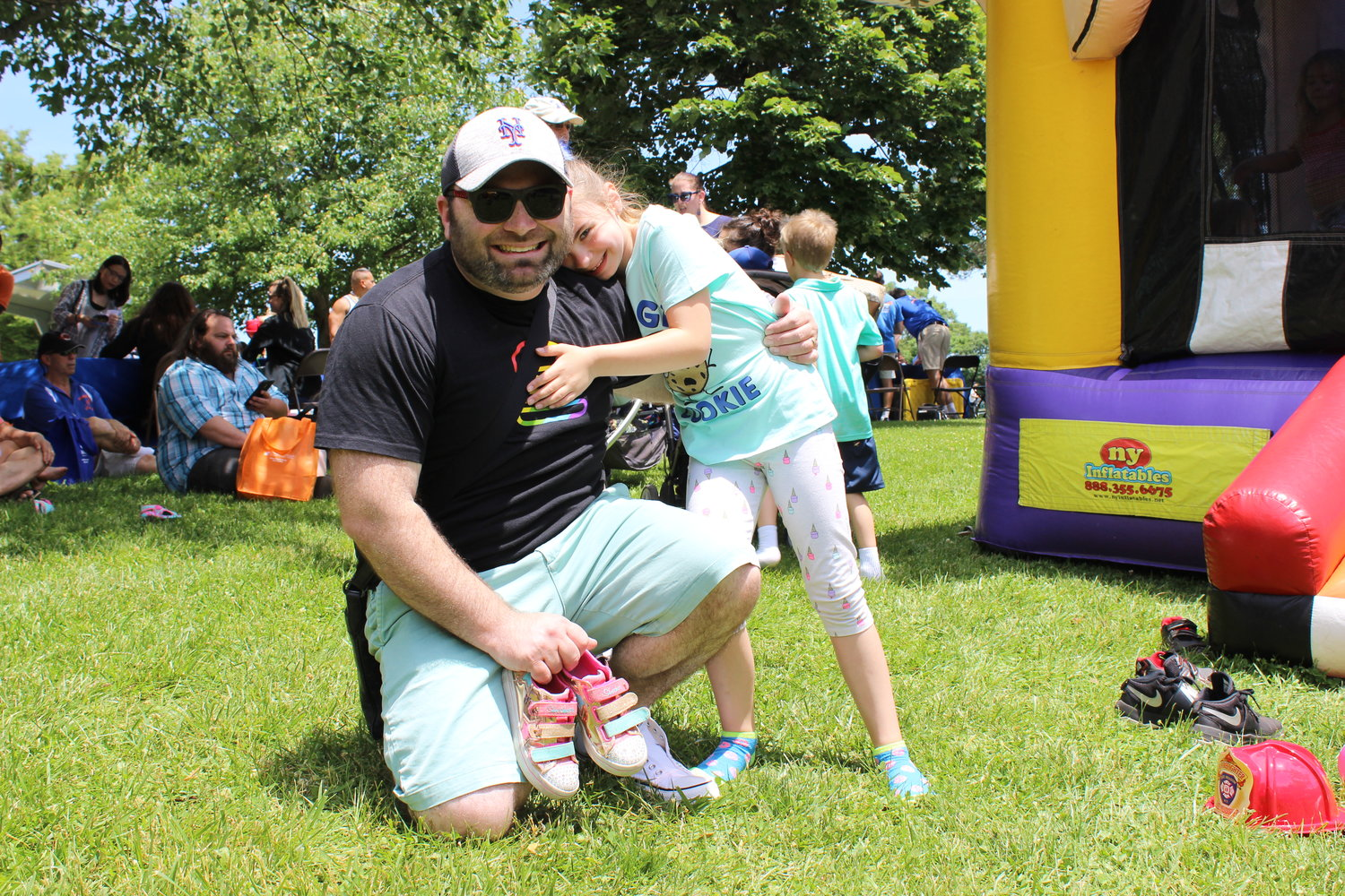 Matthew Jurgens took his daughter Madeline, 7, to the festival, where she enjoyed the bounce house.