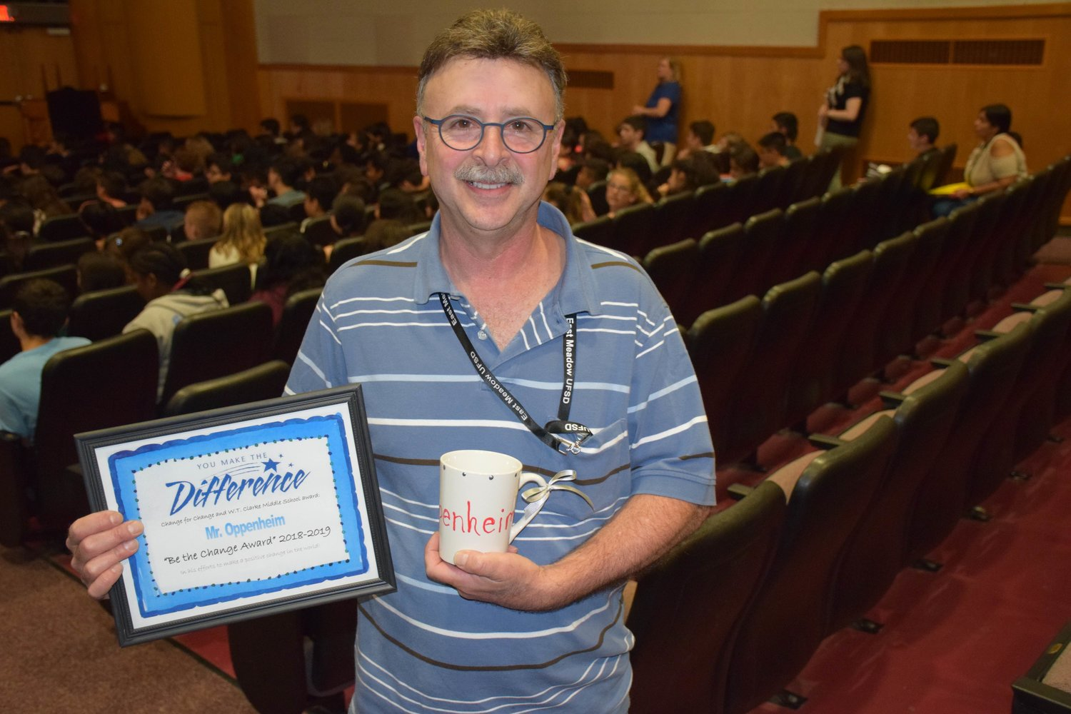 "Technology teacher Elliot Oppenheim received the school's ""Be the Change"" award."
