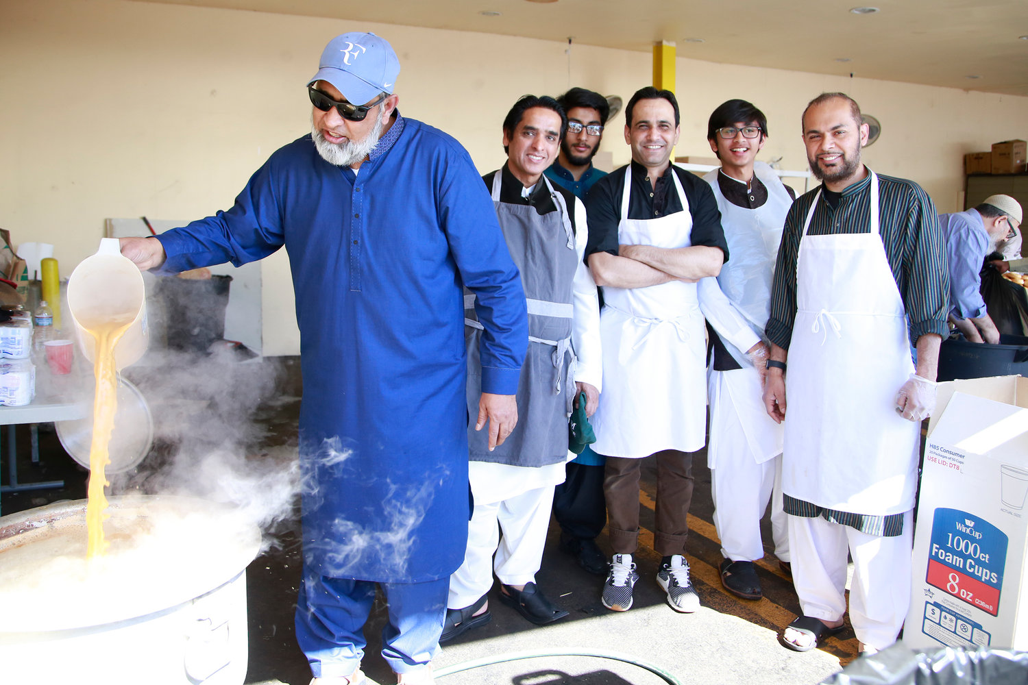 Abdoul Hameed made a special chai tea with, from left, Adnan Khan, Qumar Din, Imran Farooq, Omar Khan and Syed Riswan.