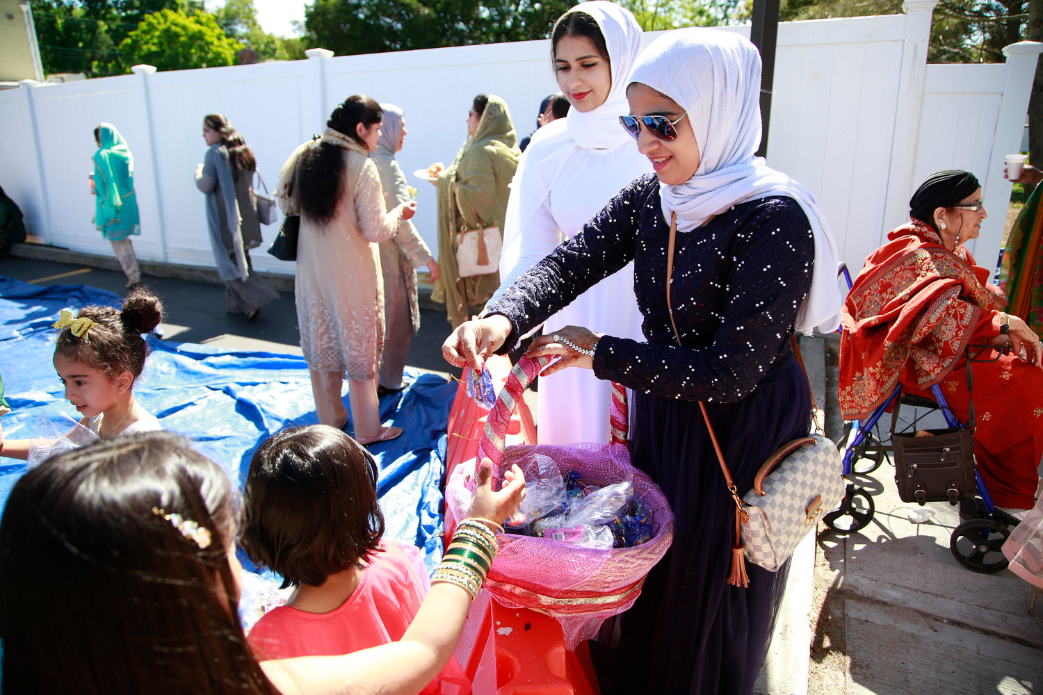 Maysa Kapadia and Musra Aahmed handed out treats to children.