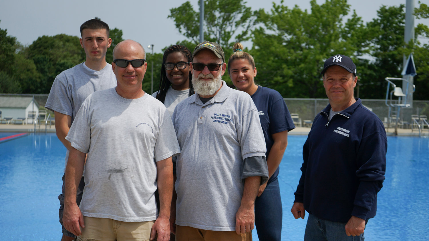 Pool Maintenance Supervisor Rich DeAngelis, center, with his staff, Frank Tashman, clockwise from top left, Stacey Charles, Kelliann Dupignac, Eugene Boening and Rob Abrams. Not pictured were staff members Mike Redden, John Lachmeyer, Lou Correa, Tom DeMatties, Annie Fitzgerald