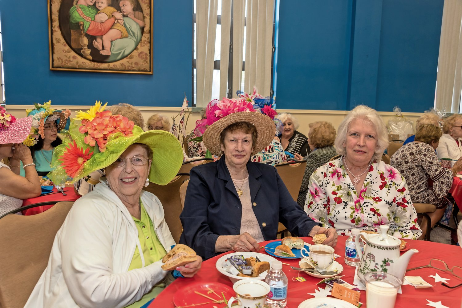 Felicia Plumb, left, Angie Capabianco and Elsa Fries enjoyed the sandwiches that were included at the Mad Hatter's Tea.