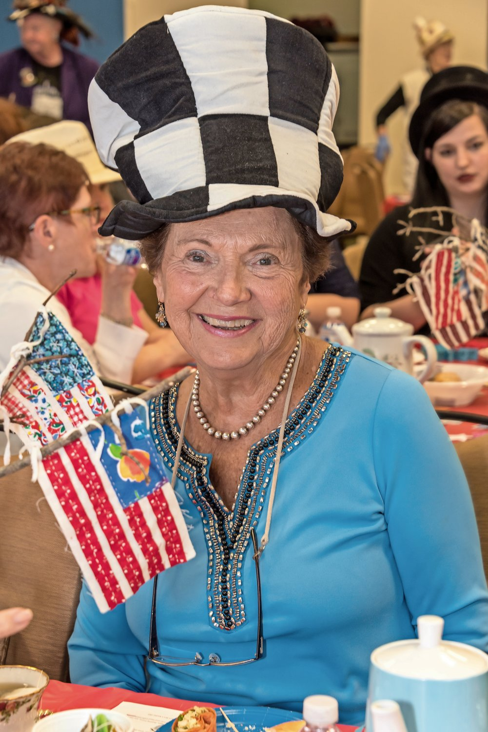 Marion Hahn joined the hat parade after lunch.
