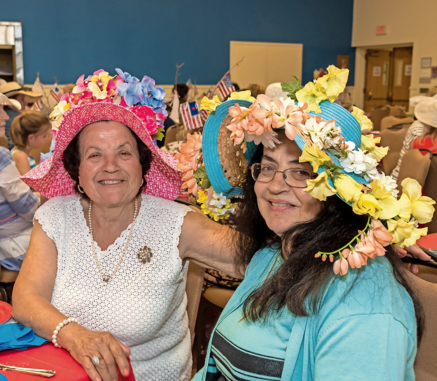 Josephine Grella, left, and Angela Pacardi worked hard on their hats.