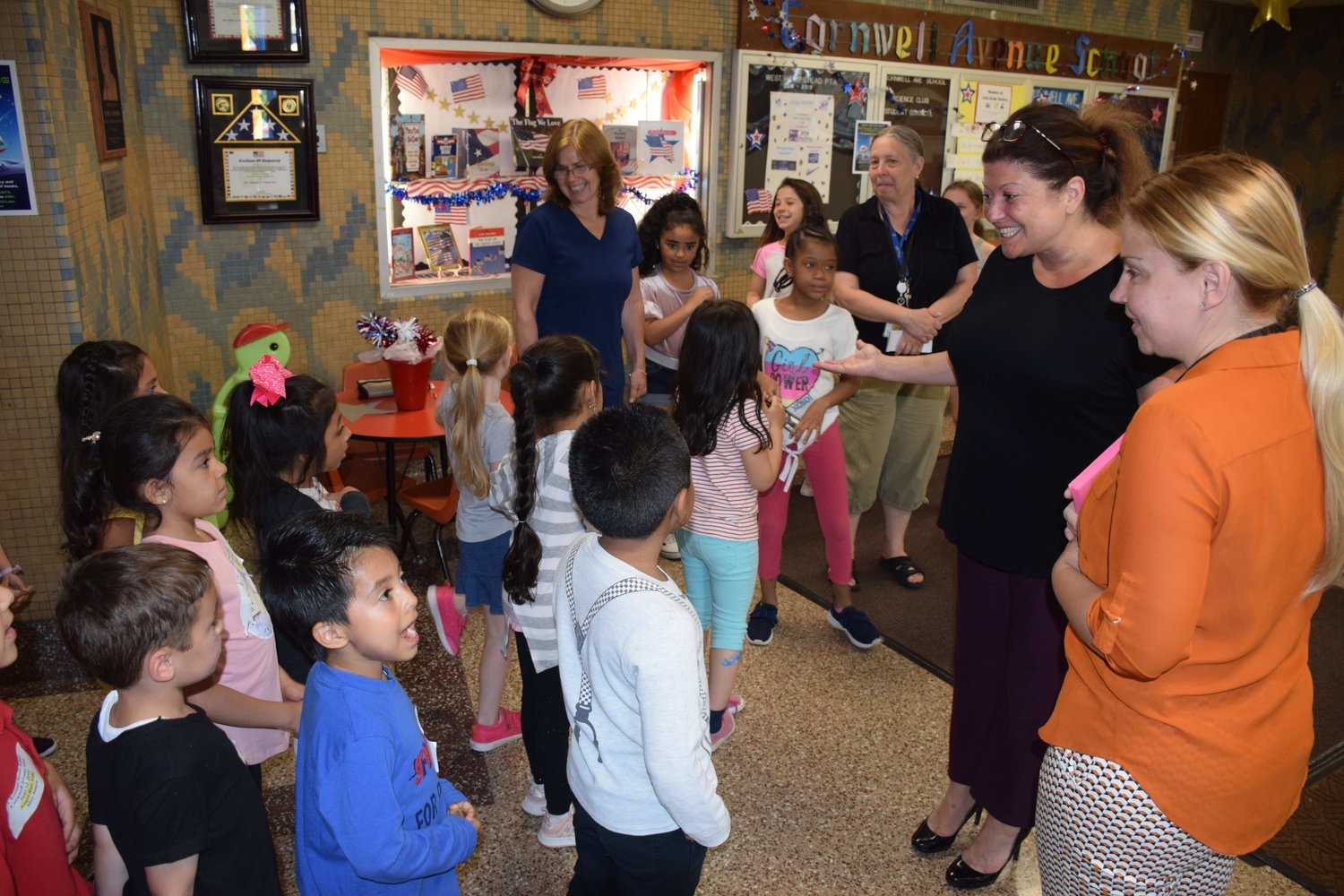 Cornwell Avenue Principal Deanna Sinito, second from right, welcomed Chestnut Street kindergarten students for a tour on June 12.