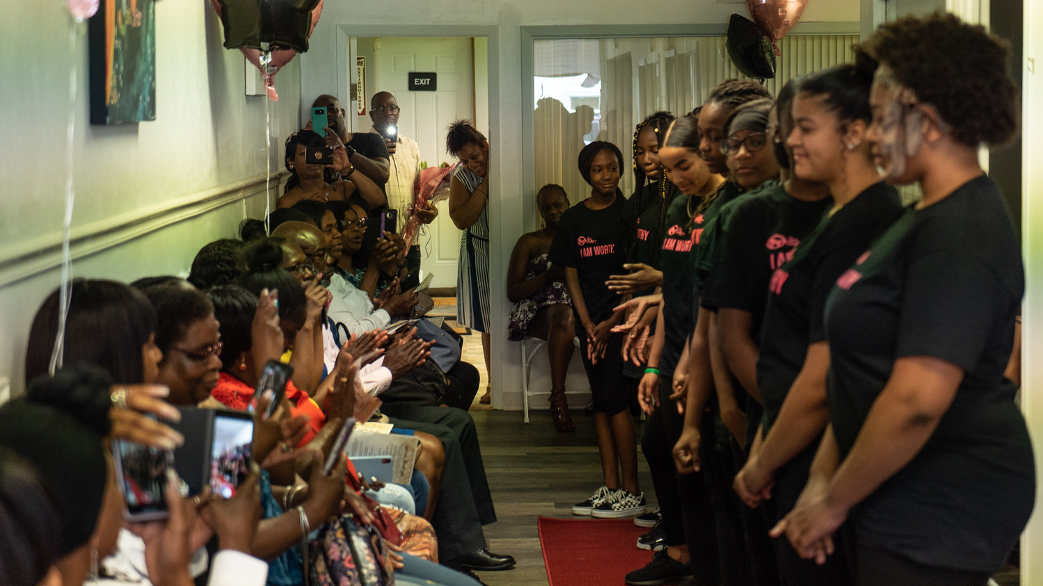 A group of girls and their parents and guardians filled 3D's Community Empowerment Center on Seaman Avenue on June 8 for the second annual Red Carpet Ceremony hosted by the local nonprofit organization Save Our Daughters Too.