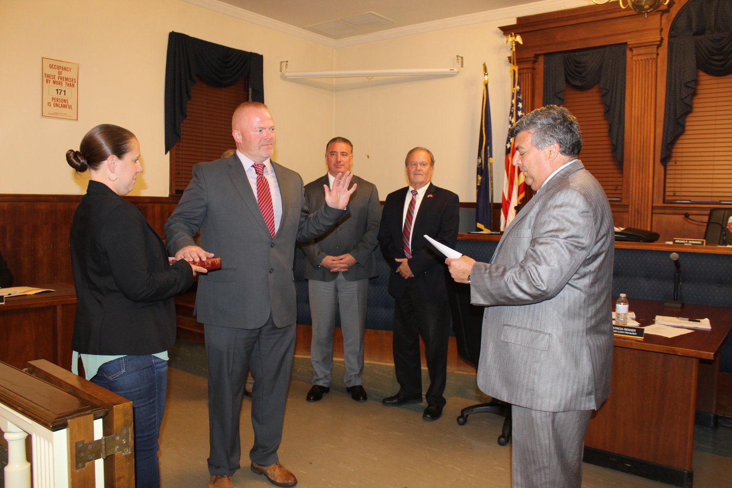 Tim O'Hagan was sworn in as an East Rockaway village trustee by Mayor Bruno Romano, joined by O'Hagan's wife, Kristen, and Trustees Richard Bilello and Gordon Fox.
