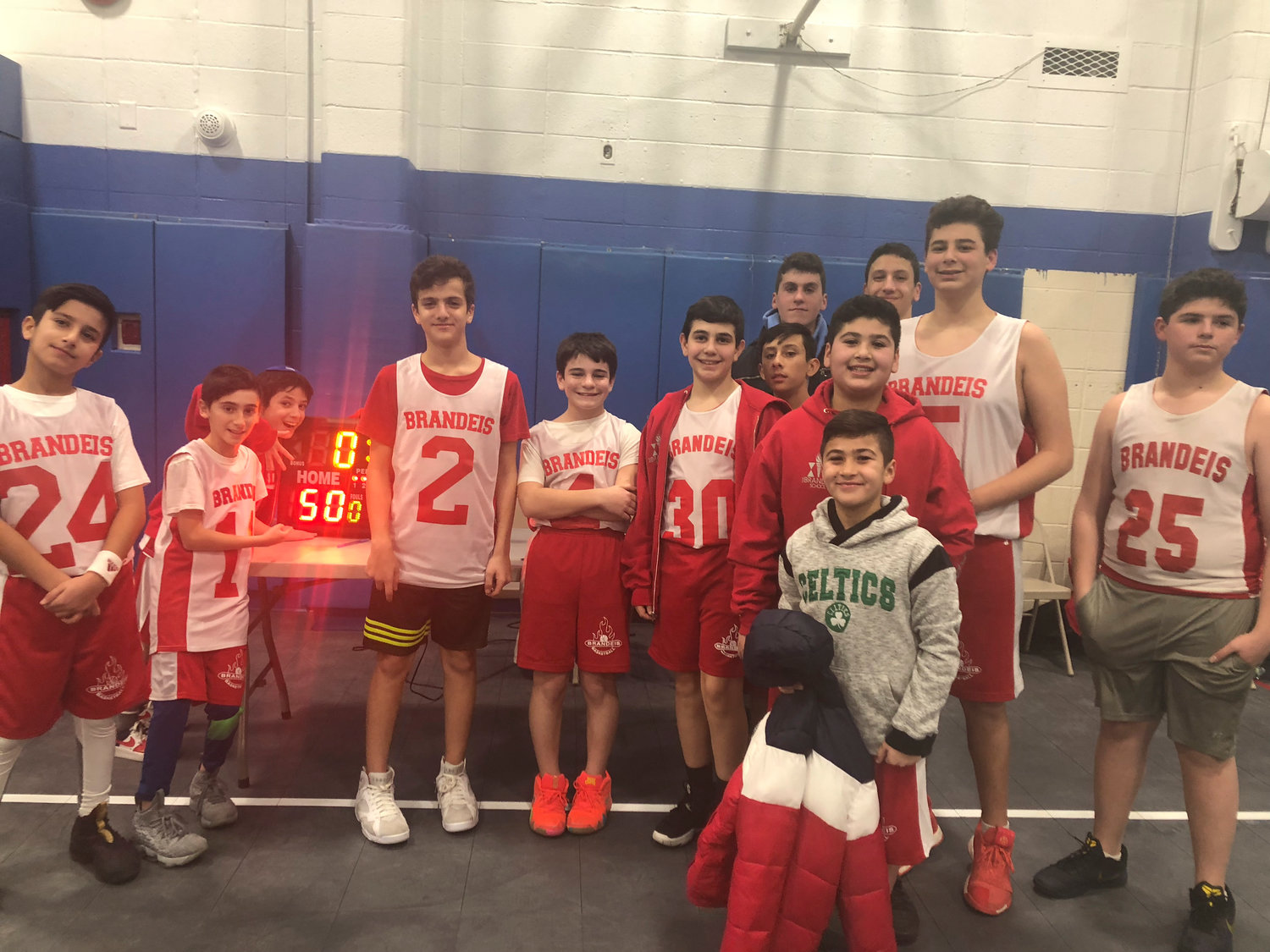The Brandeis School and the Nassau Herald are running a sports team nickname contest. Above, the Brandeis boys' basketball squad after a 50-42 victory over Yeshiva Har Torah this past season.
