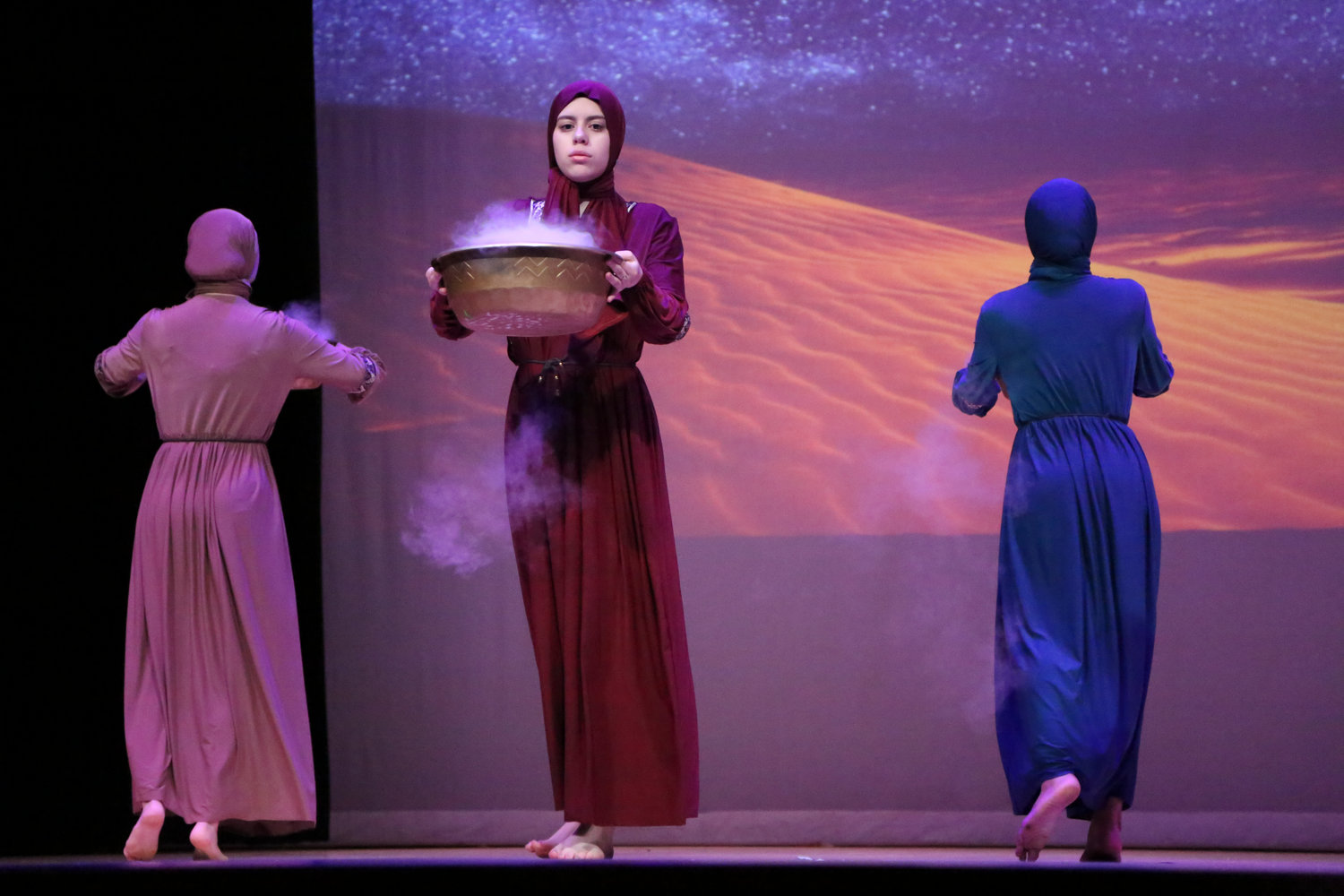 "Senior Cassandra Vladimiarv in the opening ac, ""Tea in the Sahara,"" with dry ice special effects. The dance number was choreographed by Laila Sales."