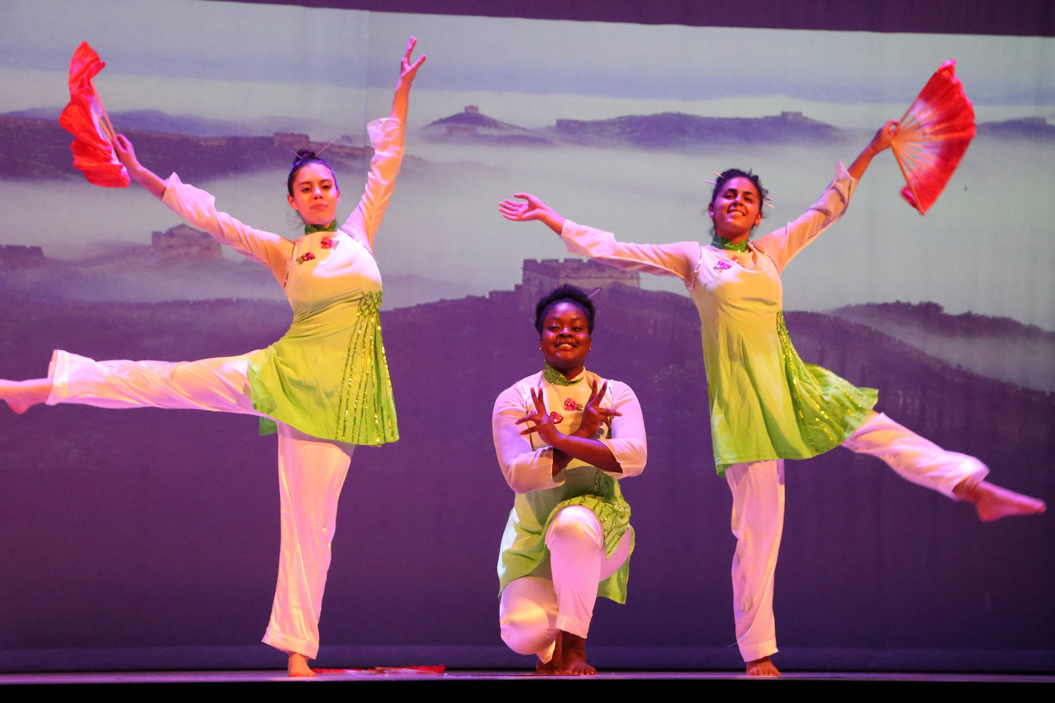 "Lawrence public schools dance department united an array of cultures in its performance on May 30. From left Cassandra Vladimiarv, Andrea Sampson, and Lainey Gonzalez performed a routine called ""Jasmine,"" choreographed by Jaili Wang."