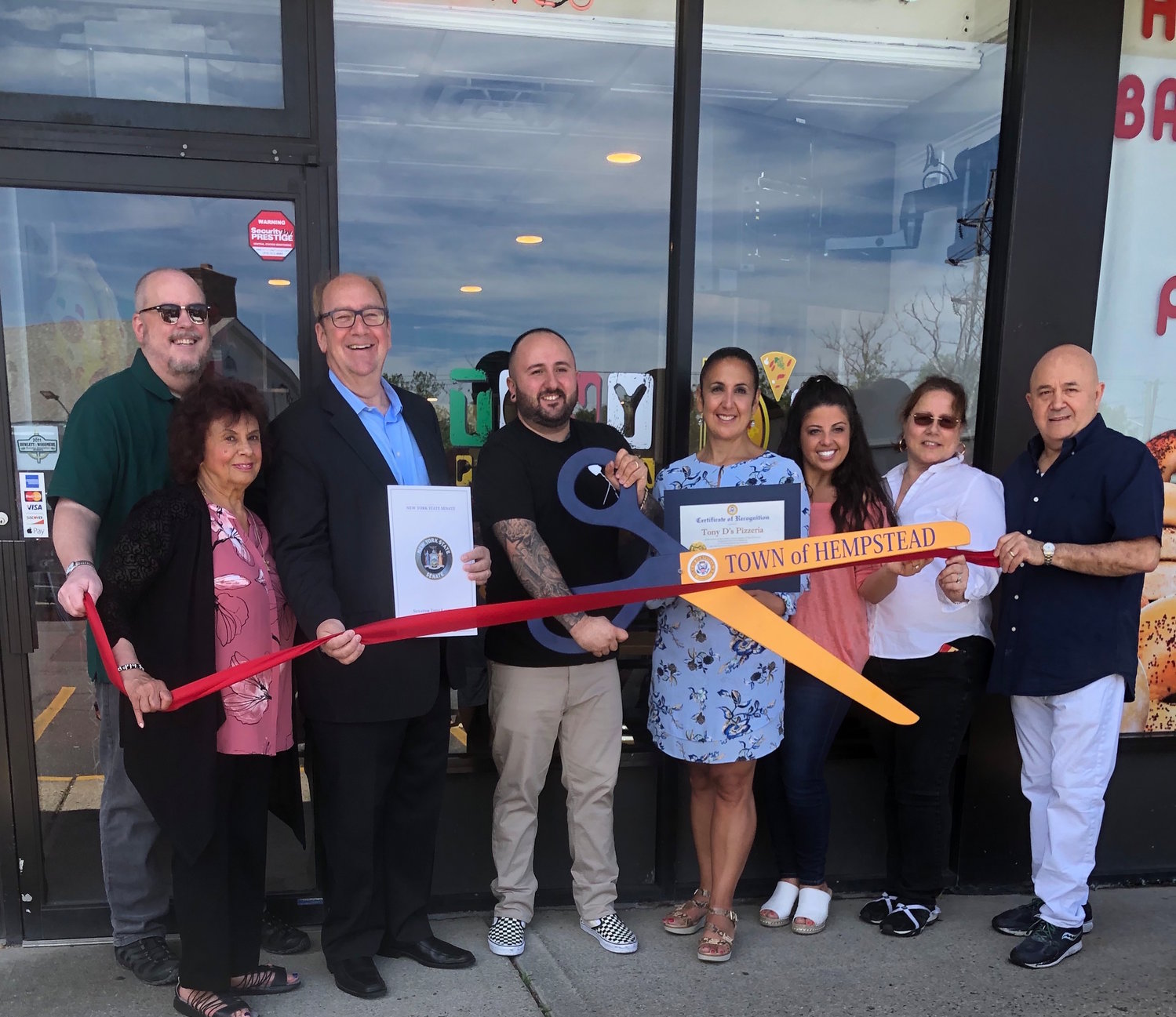 Tony D's Pizza is open in Hewlett. From left were HWBA Vice President John Roblin, Woodmere resident Ann DeMichael, HWBA President David Friedman, owner Anthony Divella, Town Clerk Sylvia Cabana, Rosemarie Divella, and Antoinette and Mario Divella, Anthony's parents.