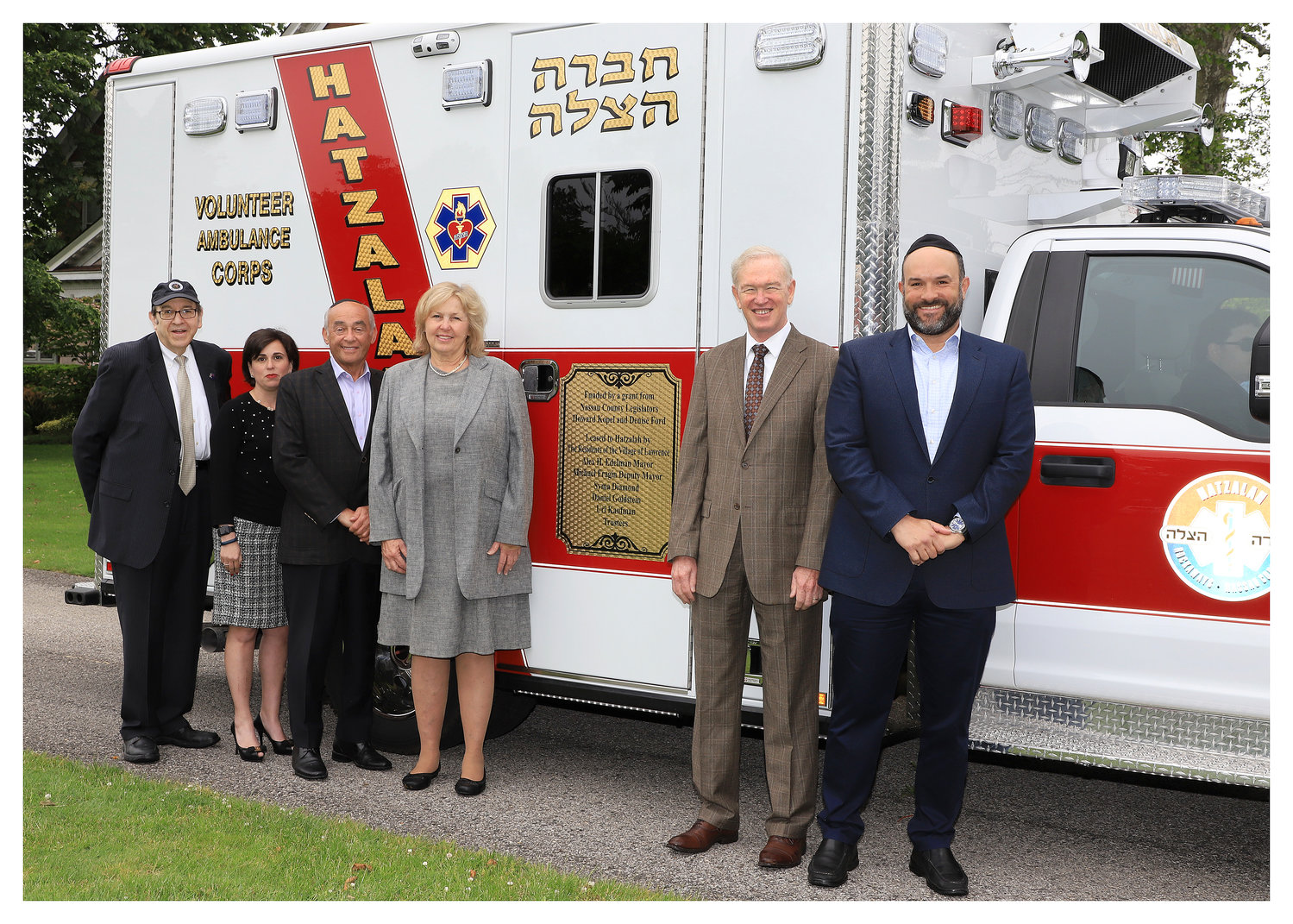 Lawrence village received a $300,000 county grant for a new ambulance that will be used mostly by Hatzalah volunteers. From left were Village Administrator Ron Goldman, Trustee Syma Diamond, Mayor Alex Edelman, County Legislators Denise Ford and Howard Kopel and Deputy Mayor Michael Fragin.