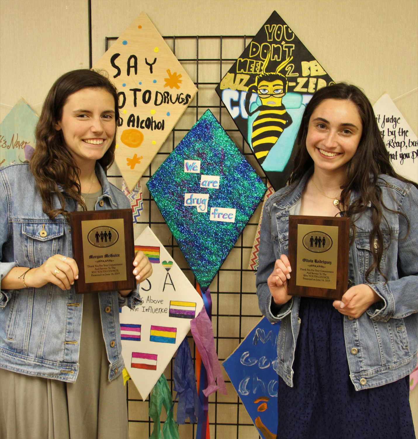Morgan McGuire and Olivia Rodriguez were thanked for their service to the Youth Council.