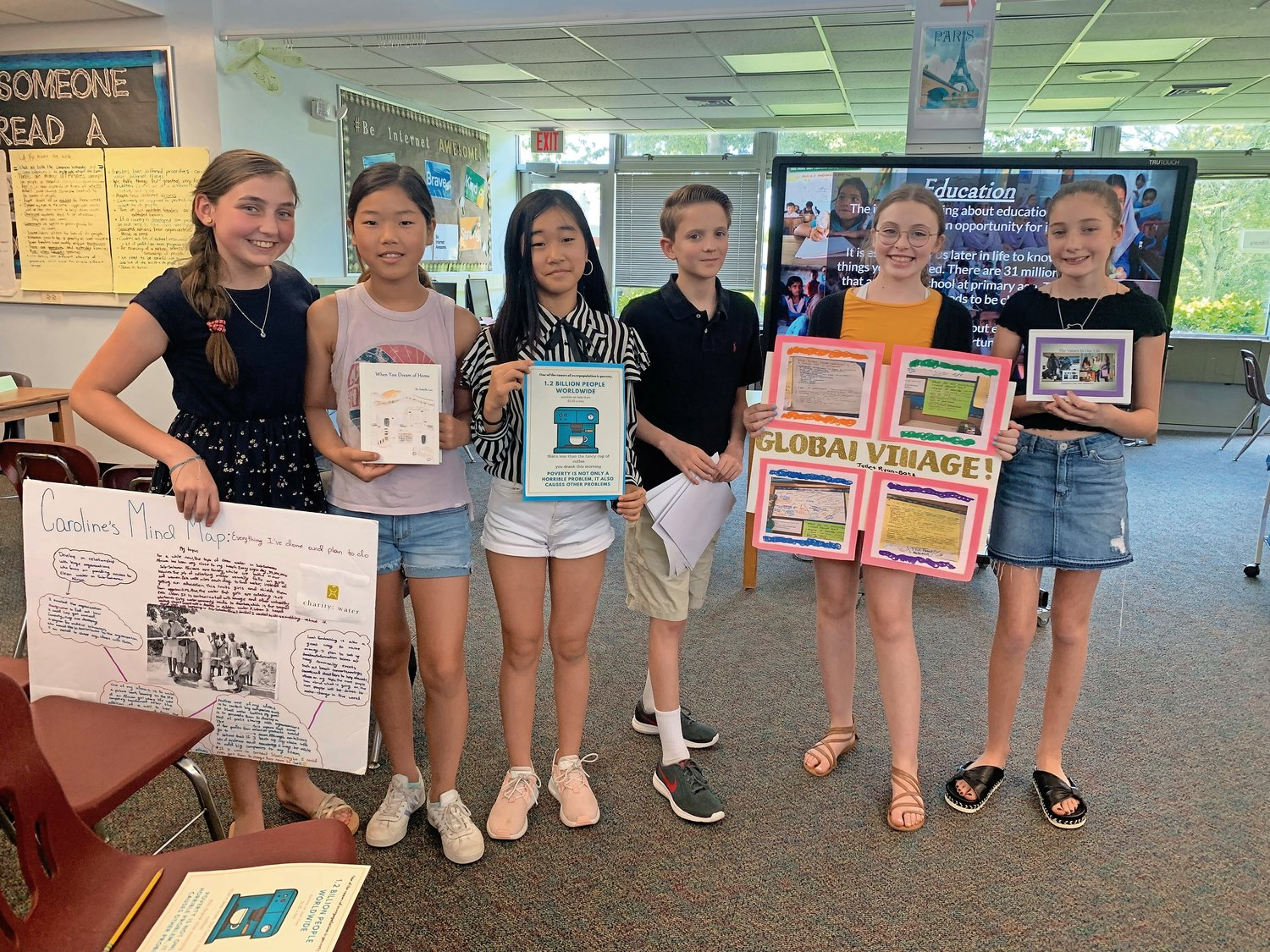 North Shore Middle School students Caroline Winchester, left, Isabelle Lee, Jazmin Ko, James Brissenden, Juliette Ryan-Baez and Olivia Bellocco showed off their action pieces at the Global Village Exhibition on June 11.