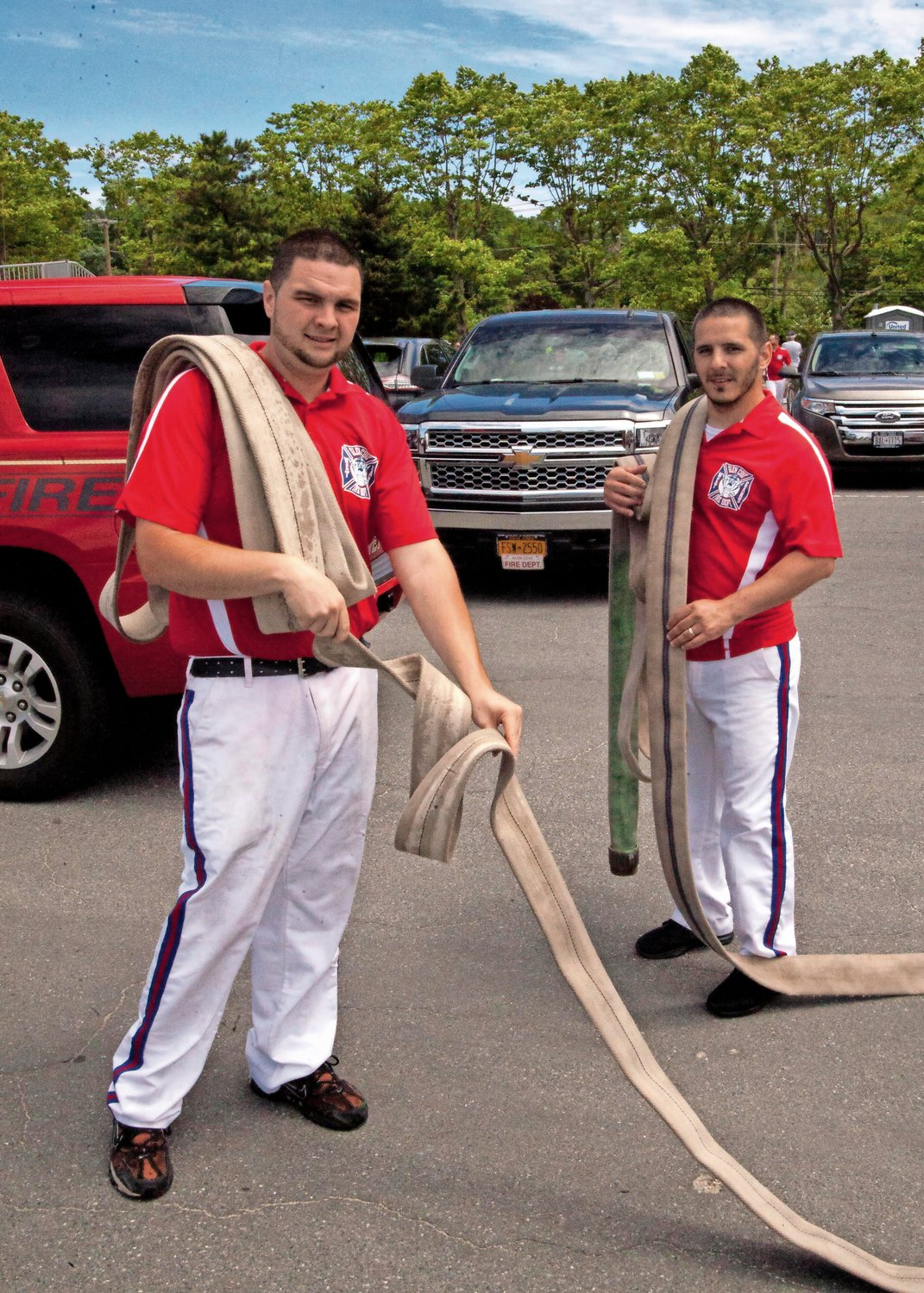 Nick Laskowski, left, and Andrew Molillo of the Glen Cove Fire Department's Wet Ears, untangled a hose on the side of the racetrack.