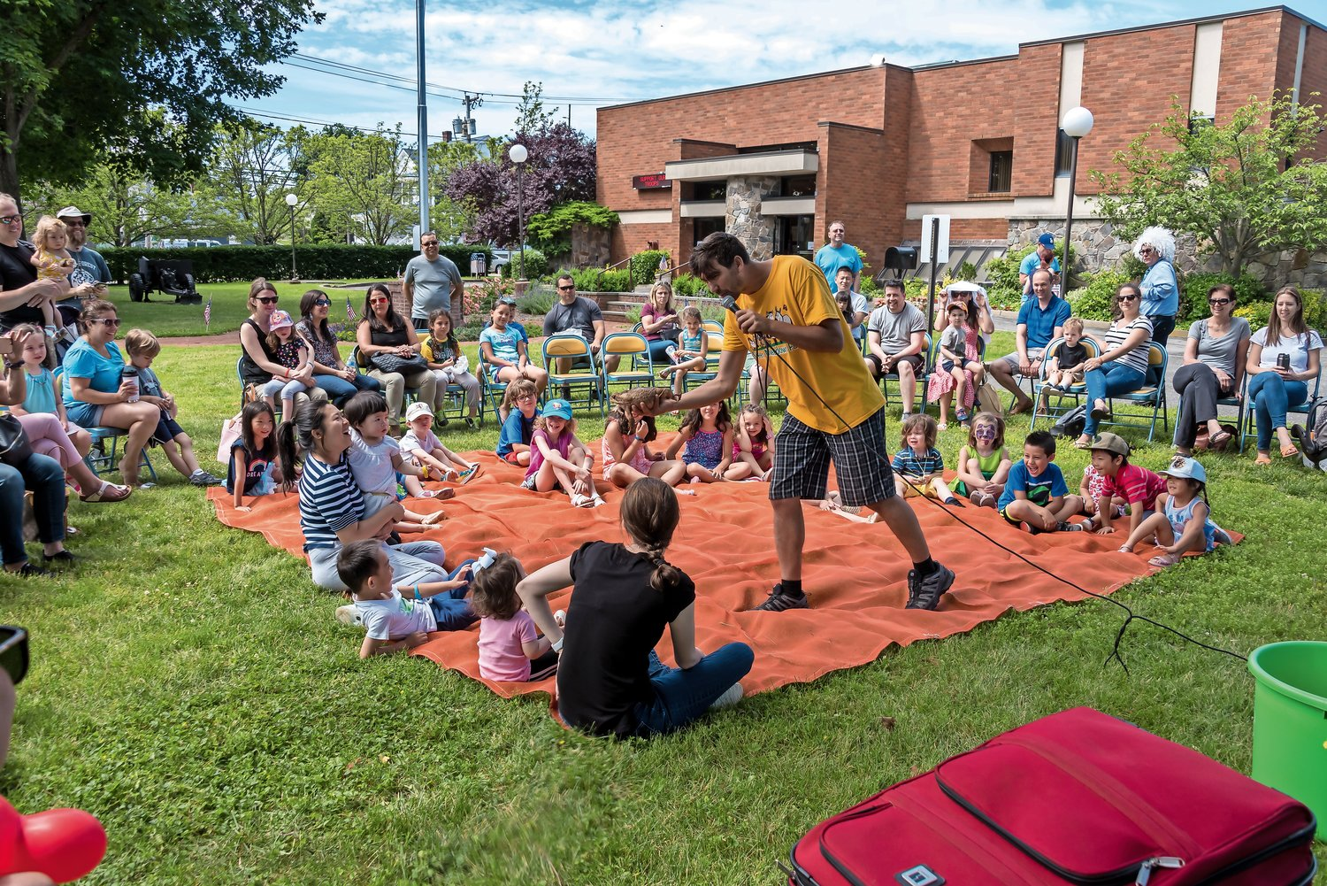 Jason Reilly from Green Meadows Farm entertained a crowd of residents at the Gold Coast Library's summer reading kick-off celebration on June 15.