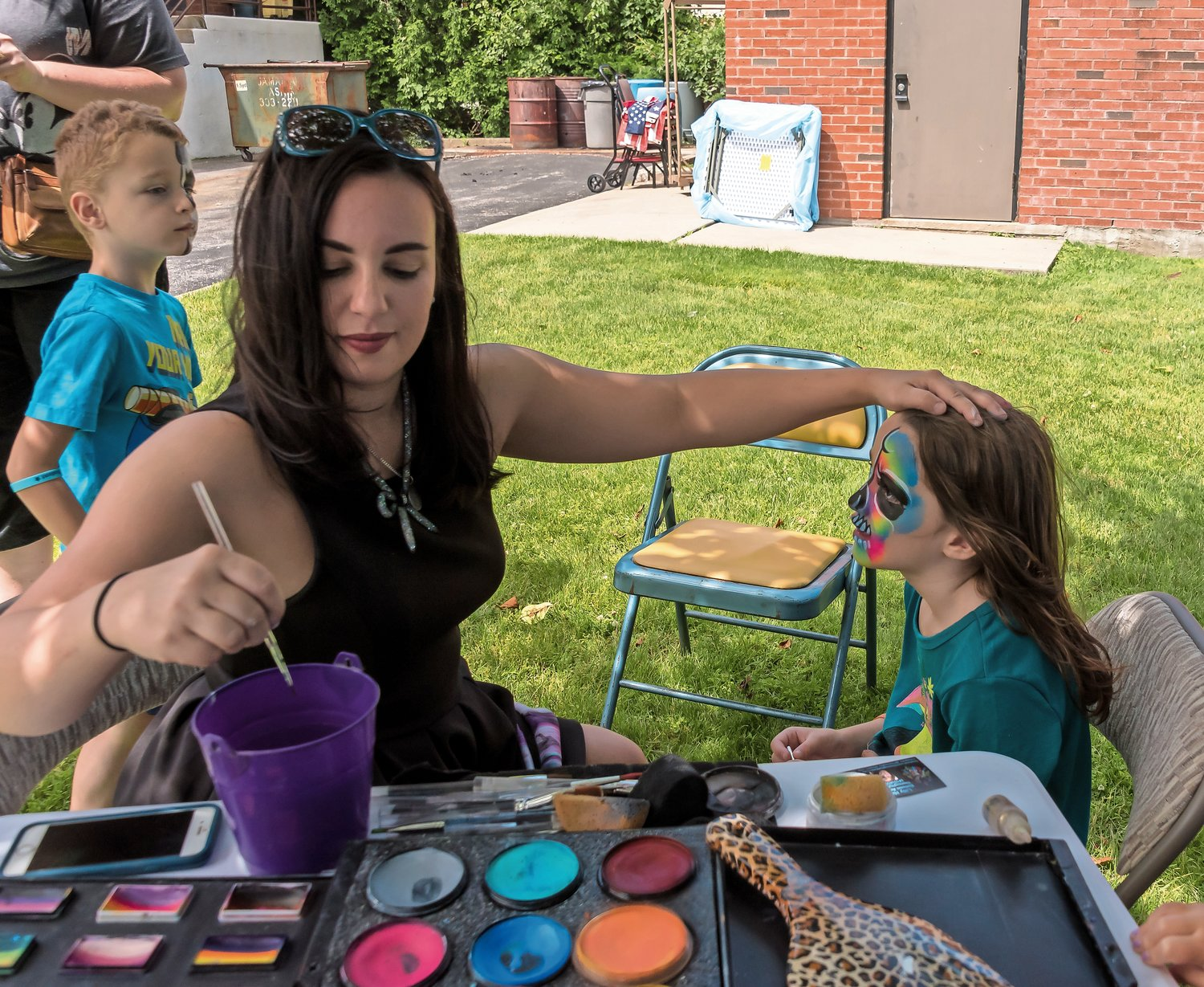 Face painter Lilly Hayes gave Julia Reed, 6, a Technicolor paint job.