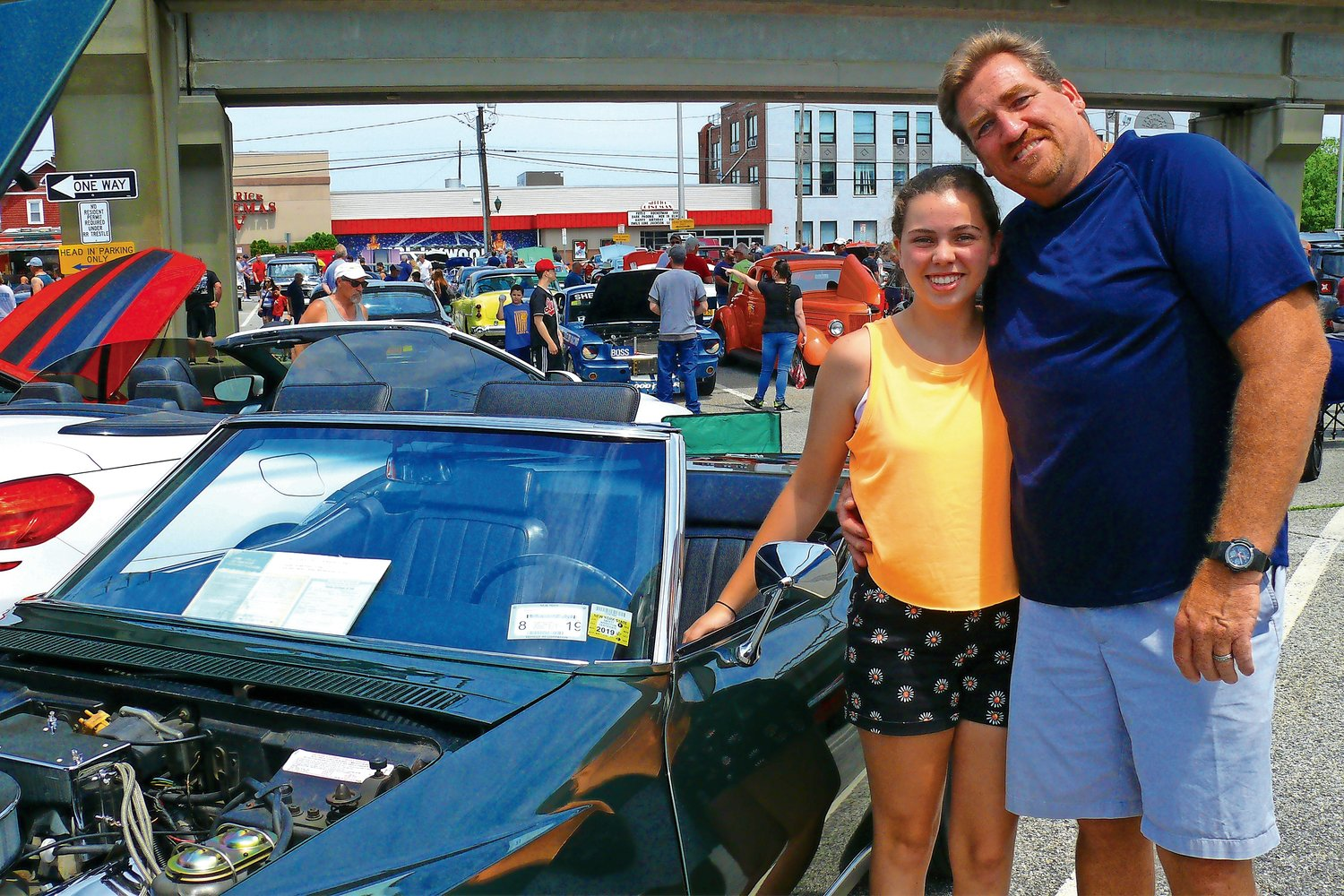 Father-daughter duo Grace and Thomas Toner showed off their Chevrolet Corvettes at the Father's Day car show at the Merrick train station. Their cars were among hundreds at the show.