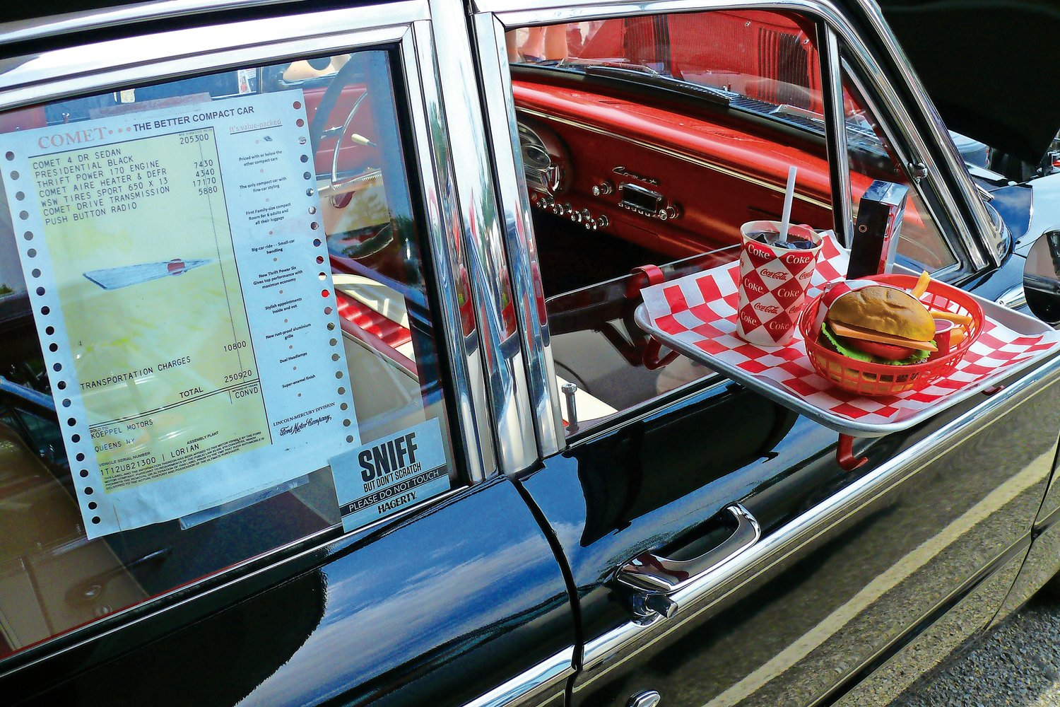 A 1961 Mercury Comet (with its original bill of sale) was parked at the Merrick train station on Sunday. The display of an old-school window service tray — complete with a burger and soda — took fathers on a blast to the past.