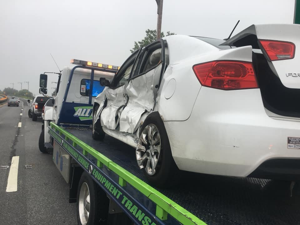 A white Kia Forte was removed from the scene of the crash.