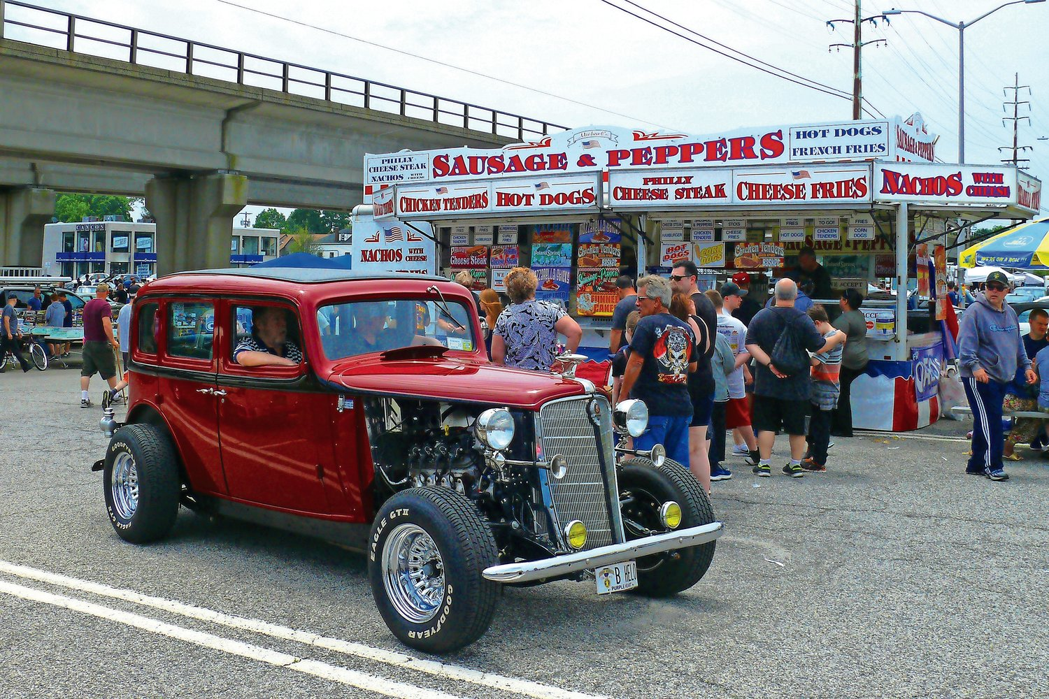 A classic Hot Rod slowly rolled through the event in search of a spot to show off its eye-catching restoration.