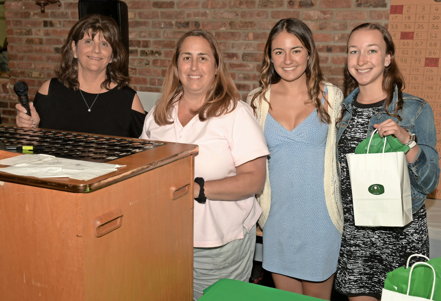 Parks and Recreation Director Darcey Belyea, far left, helped run the raffle, with Leslie Maccarone Baptista, Erin Moore and Lindsey Payton.