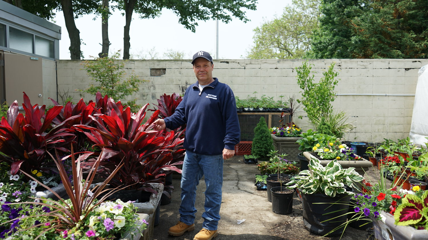 Village horticulturist Eugene Boening in his garden at the Hendrickson Park pool facility. His plant arrangements can be seen throughout Valley Stream.