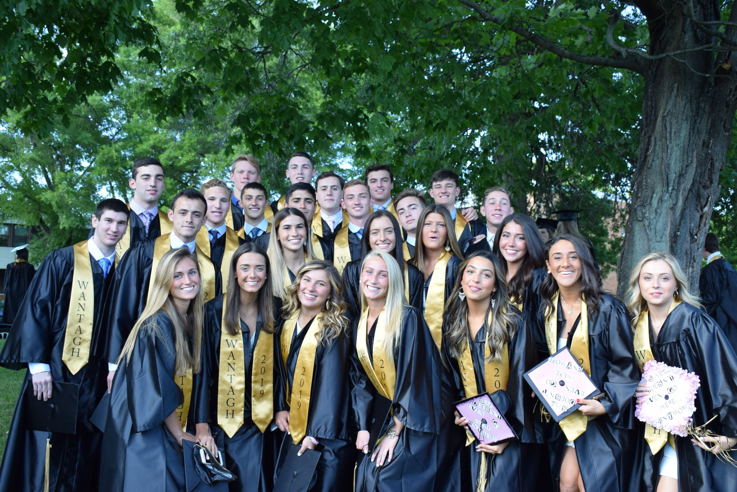 It's a  tradition for graduates to pose for photos on the front lawn of Wantagh High before graduation, according to a Wantagh School District news release.