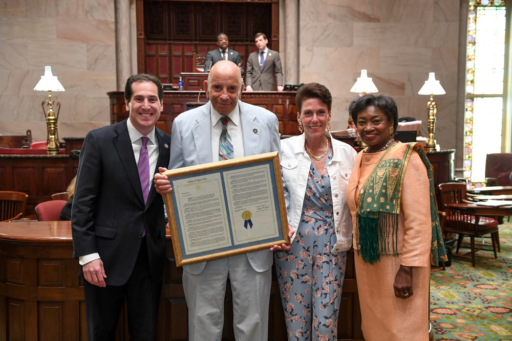 State Sen. Todd Kaminsky, far left; former Assemblyman Harvey Weisenberg and his daughter, Vicki Laufer; and Senate Majority Leader Andrea Stewart-Cousins.