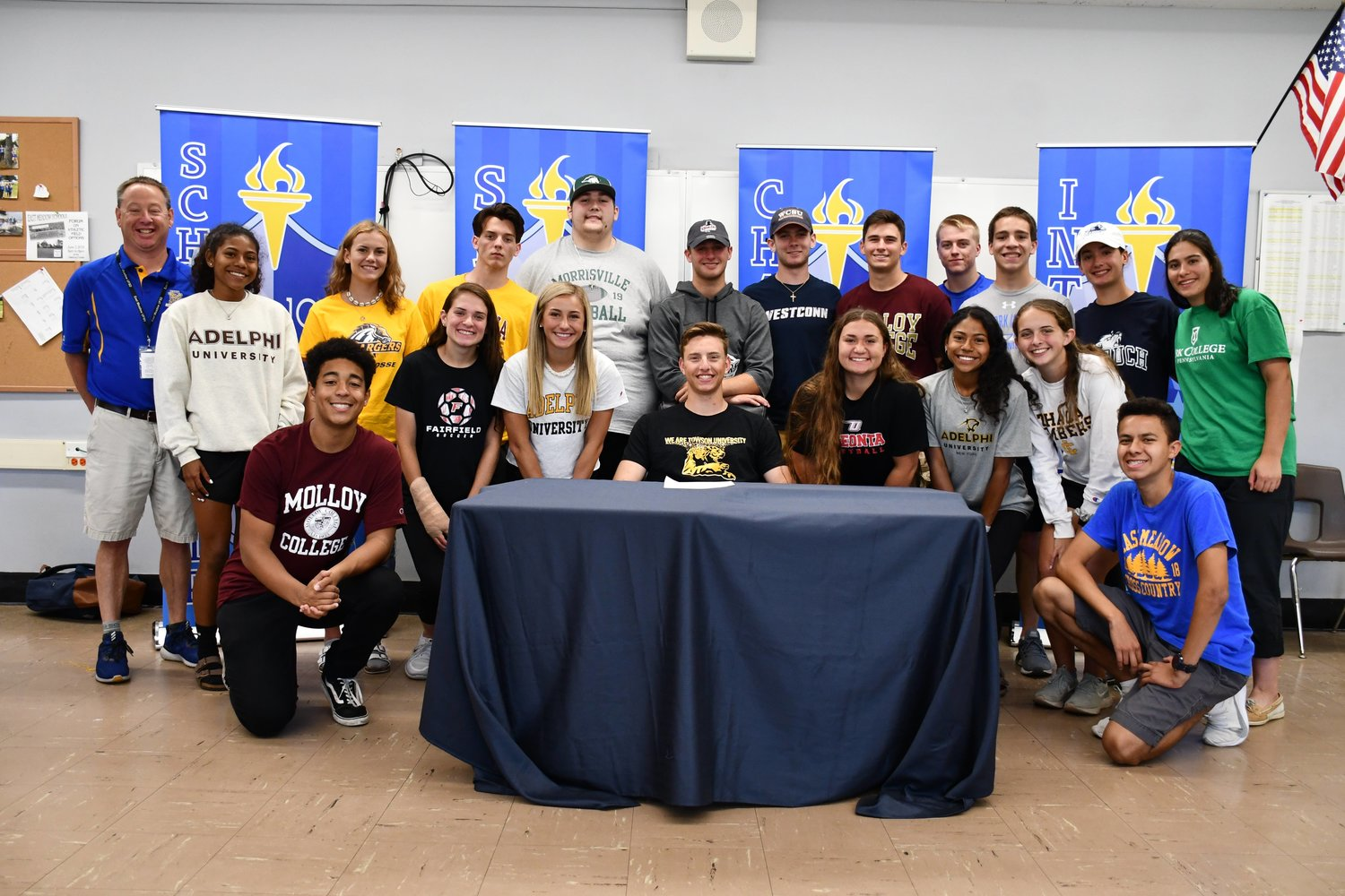 Students at East Meadow High School committed to continuing their athletic careers at the college level on June 6.