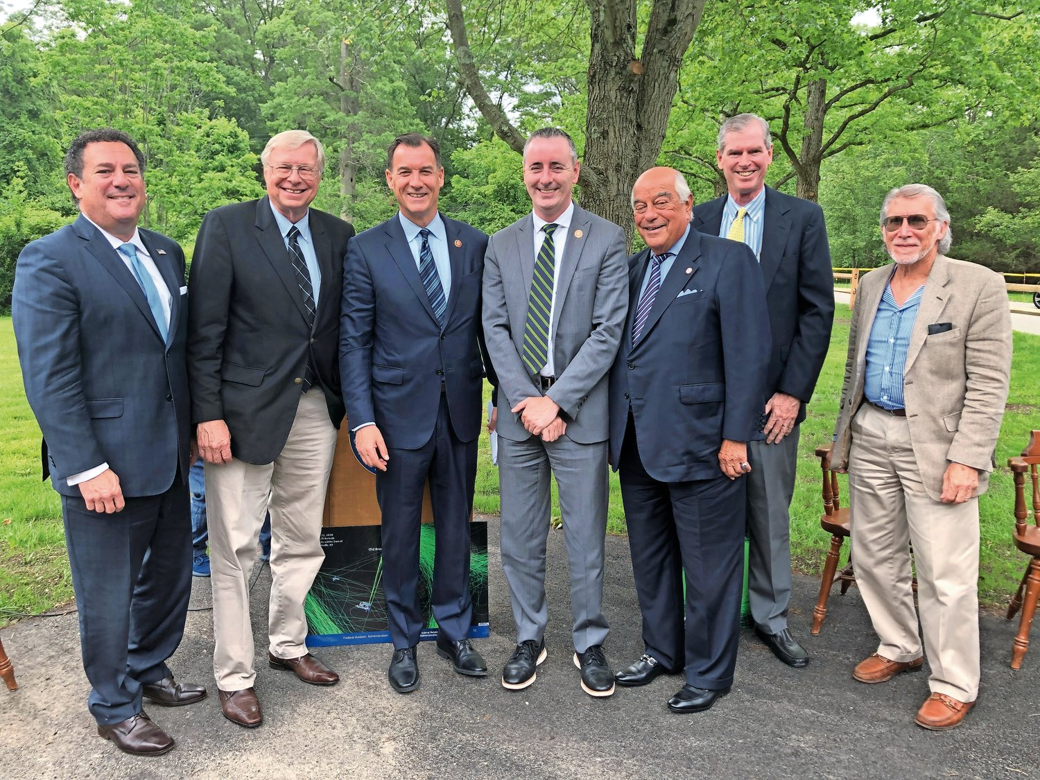 Attending the press conference were, from left, Daniel Serota, Brookville mayor; Bernie Ryba, Old Brookville mayor; U.S. Rep. Tom Suozzi; Rep. Brian Fitzpatrick, whose suburban Philadelphia district is similarly affected by aircraft traffic and noise; Marvin Natis, North Hills mayor; Ed Madden,Upper Brookville deputy mayor, and Paul Peters, Roslyn Estates mayor.