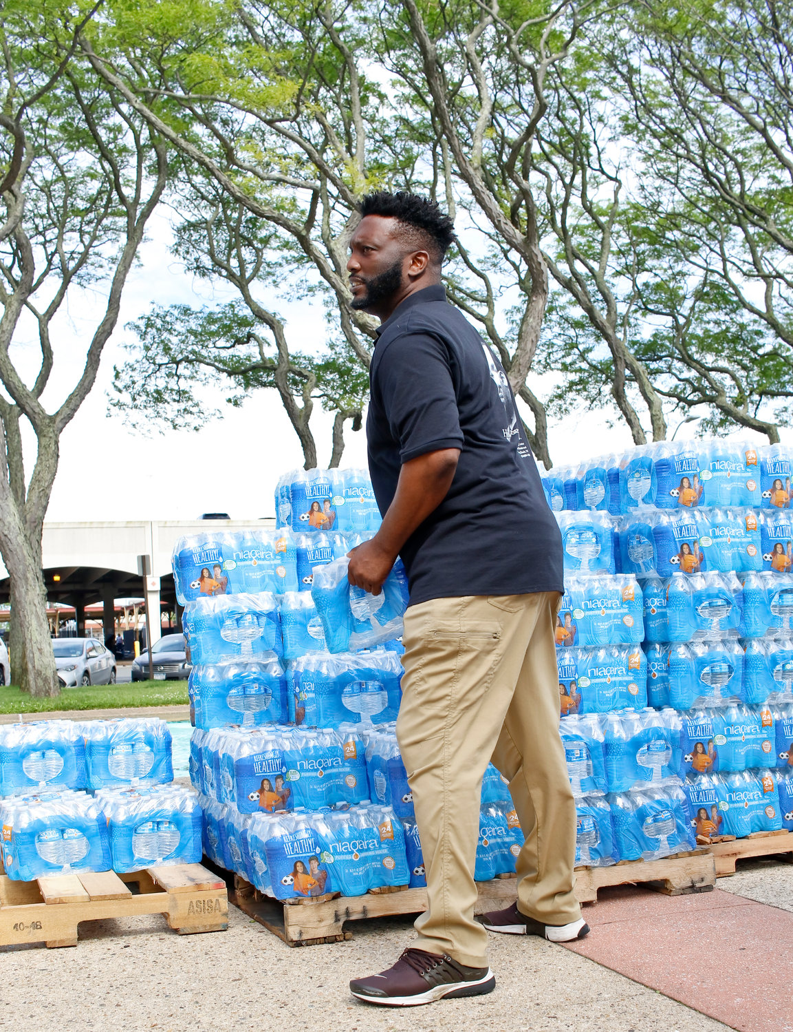 MLK Center board Chairman James Hodge gave out water to residents.