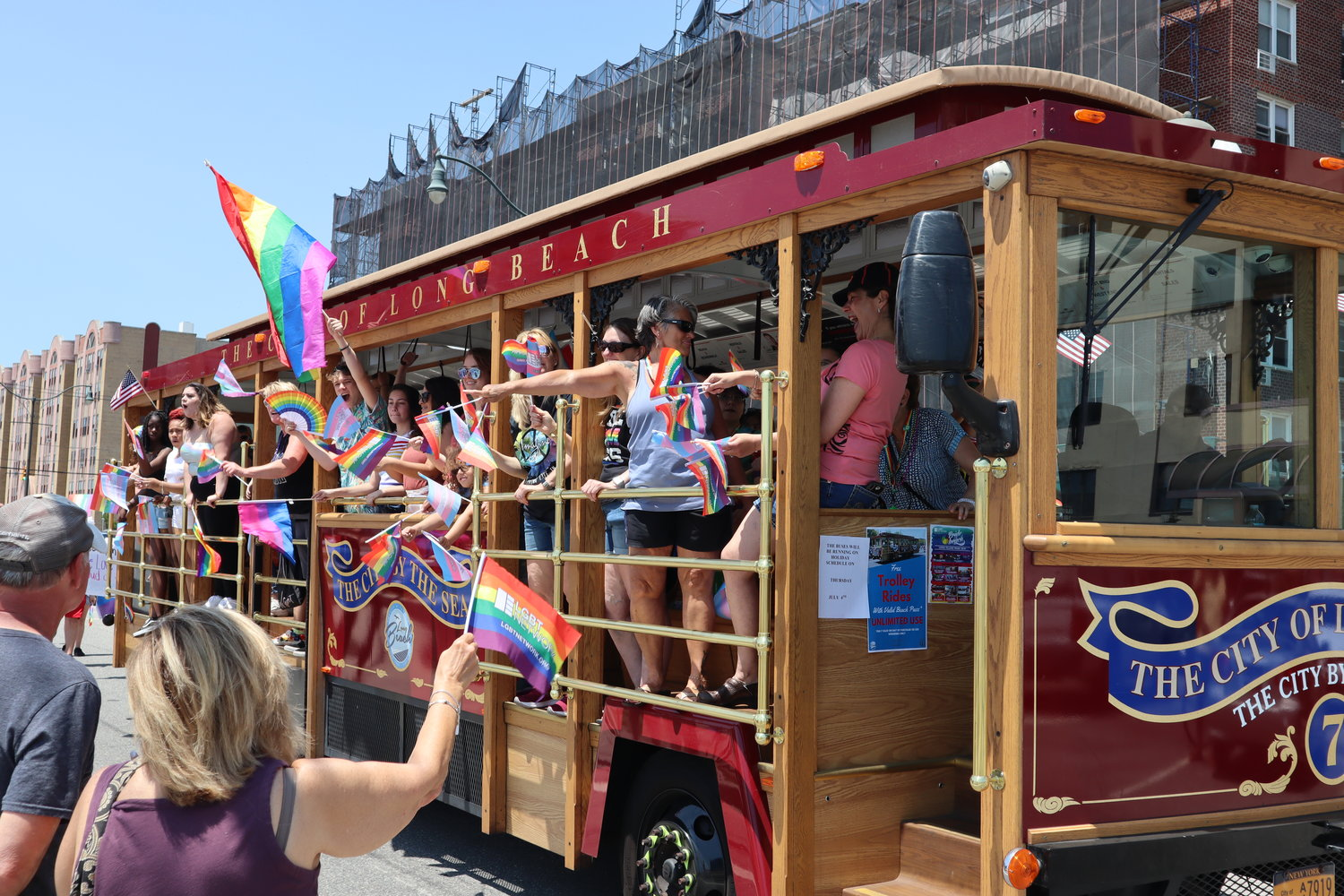 LGBT supporter waved rainbow flags outside a City of Long Beach bus during the 29th annual Pride Parade on Long Island.