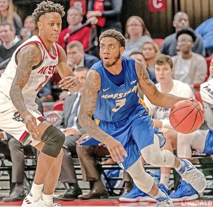 Hofstra's two-time Colonial Athletic Association Player of the Year Justin Wright-Foreman, right, was selected by the Utah Jazz in the second round of the NBA Draft.