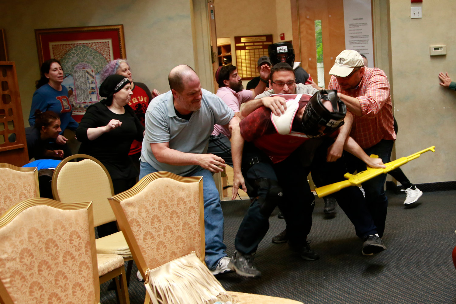 Residents took part in a training simulation that involved a play-acting assailant at Anshei Shalom in West Hempstead on June 16.