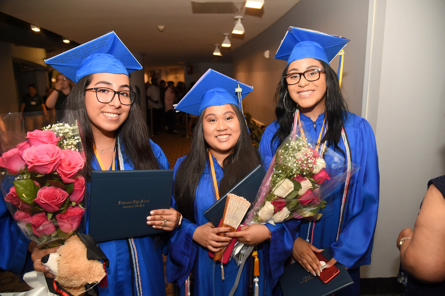 Jezebel Guerra, Marielle Cardenas and Nya Jackson shared a post-graduation moment.
