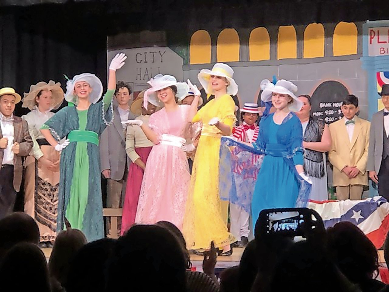 "Sophia Yaker, left in the green dress, and Ryan Benevenuto, in the yellow dress, performed in South Middle School's ""The Music Man Jr."""