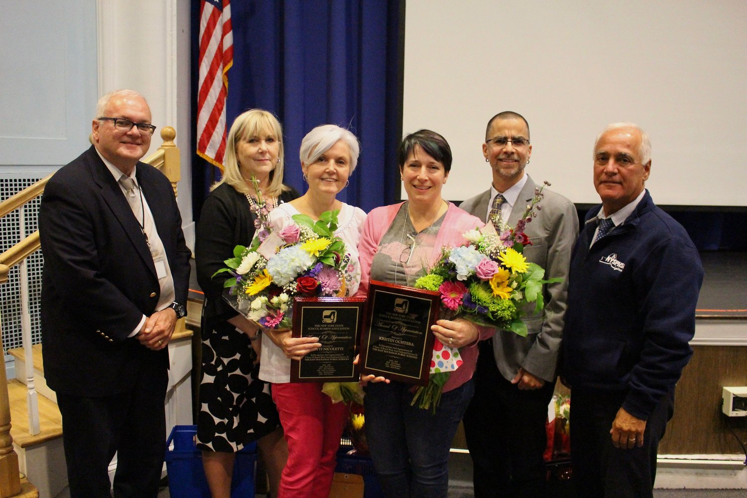 Outgoing longtime Board of Education Trustee Patti Nicoletti and Vice President Kristin Ochtera, center, were recognized by, from left, Trustee Neil Schloth, Superintendent Lisa Ruiz, board President Keith Gamache and Trustee Dom Vulpis.
