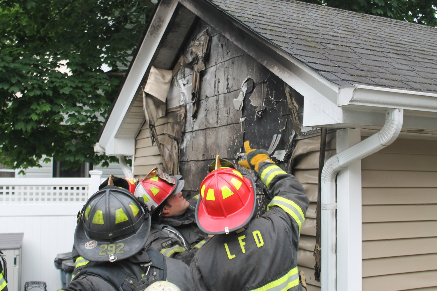 Lynbrook firefighters inspected the damage to the garage and made sure the fire was out.