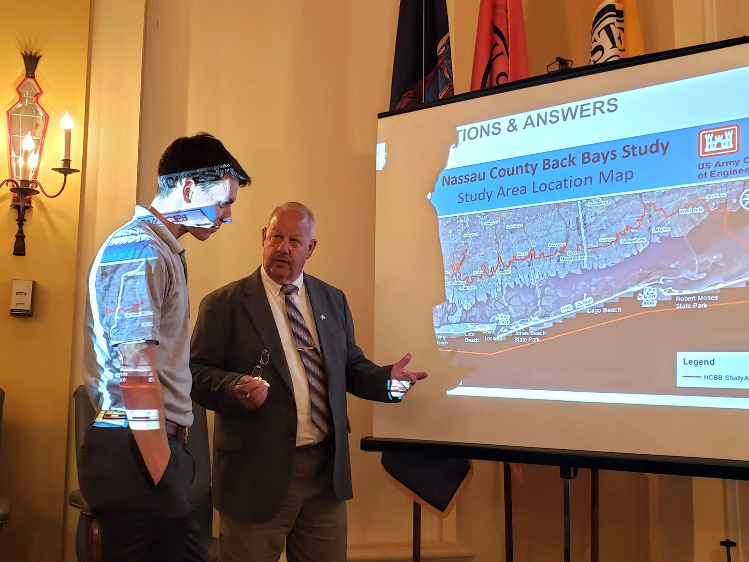 Rob Hampson, a hydraulic/coastal engineer with the Army Corps of Enginners, left, reviewed the Back Bays study with Freeport Mayor Robert Kennedy.