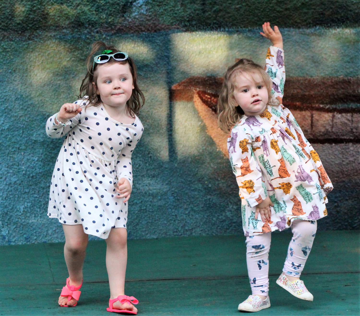 Lucy Cain, 4, left, and her sister Natalie, 2, moved to the disco music at the 1970s-themed fifth birthday party of the Baldwin Community Garden on June 21.