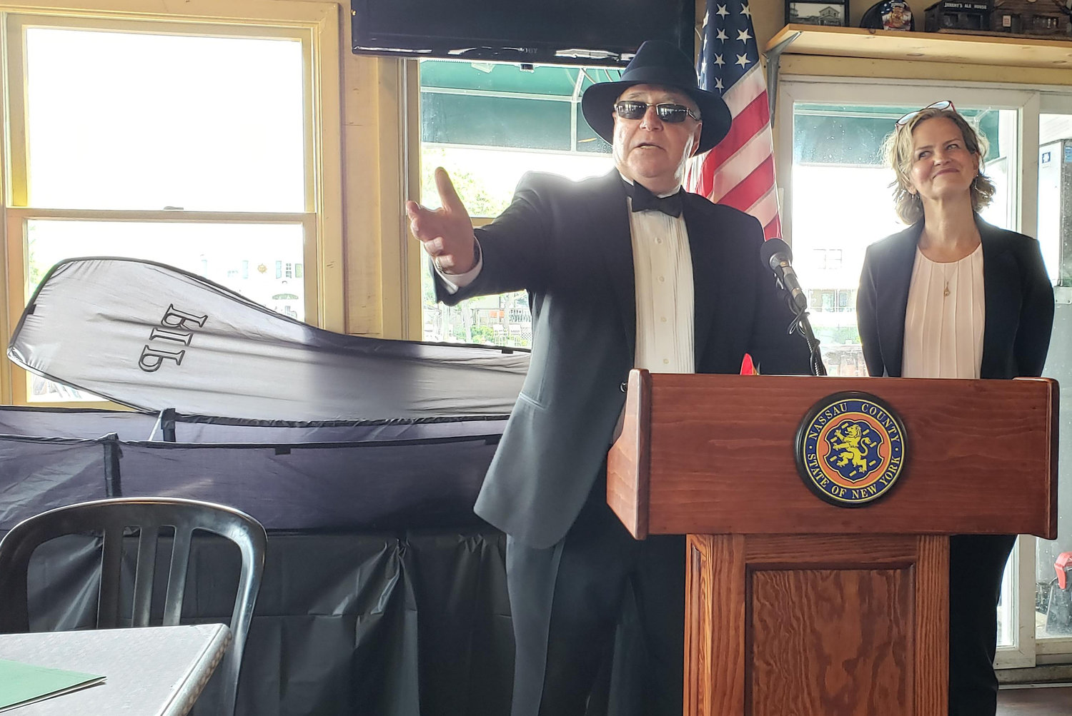 Jeremy Holin, owner of Jeremy's Ale House shared a lighthearted eulogy and a formal farewell of plastic foam.
